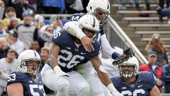 Tailback Saquon Barkley (26) figures to be one of the top draws at the newly-designed autograph session before Saturday's Blue-White Game.