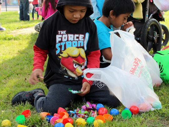 A young boy counts his eggs after the ninth annual PAL Easter Egg Hunt in Lincoln Oval Park, Saturday.