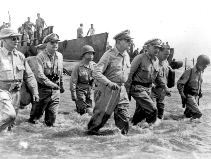 Gen. Douglas MacArthur (center) vowed to one day return