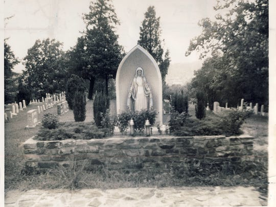 A grotto with a statue of Mary, shown in 1958, was