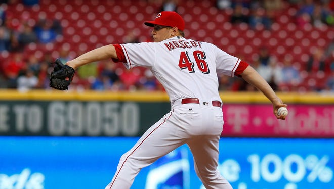 Cincinnati Reds starting pitcher Jon Moscot throws against the Chicago Cubs during the second inning at Great American Ball Park.