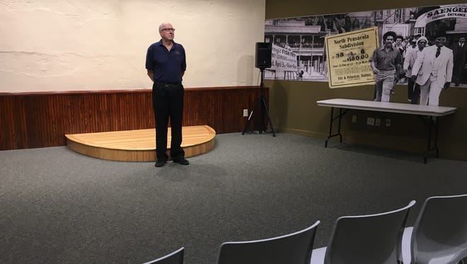 Jim Norton, founder of the Spring Screen Series stands inside the Voices of Pensacola building downtown, and prepares for the upcoming film festival on March 4 and 5. He has handpicked nine diverse films and will offer each showing for $5, along with free wine for those who are of age.