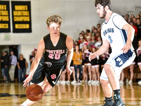 Foothill High's Carter Smith, left, dribbles past Pleasant Valley's Kyle Lindquist in March during the Northern Section Division III championship at Butte College. Smith has been chosen for the all-Northern Section first team.