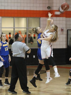 Veribest High School's Kameron Salvato (left) and Robert Lee's Kelby Clawson fight for the opening tip in a District 14-1A girls basketball game at the Robert Lee gym on Friday, Jan. 12, 2018.