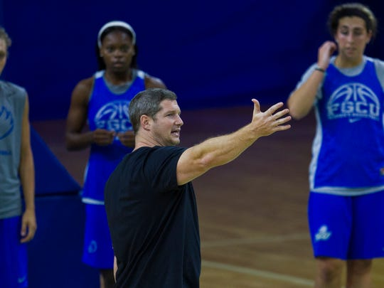 FGCU women's basketball head coach Karl Smesko, conducts skill drills during the first day of practice Monday afternoon at Alico Arena.