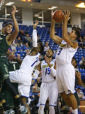 Blue Hens sophomore Skye Johnson (far right), seen here in Delaware's December win over South Florida, must have surgery on a skull fracture and will miss a month.
