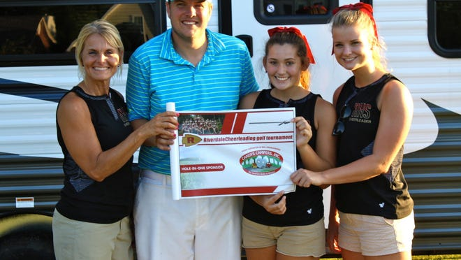 Dan Ebbutt, second from left, hit a hole-in-one during the Riverdale cheerleaders' golf tournament on Friday. From left, are cheerleading coach Brooke Wyant, Ebbutt and cheerleaders Regan Smith and Madison Josey.
