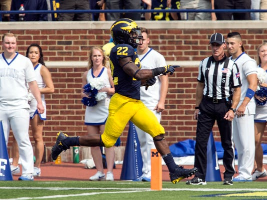 Michigan running back Karan Higdon (22) scores a touchdown in the fourth quarter of an NCAA college football game against Air Force in Ann Arbor, Mich., Saturday, Sept. 16, 2017. Michigan won 29-13. (AP Photo/Tony Ding)