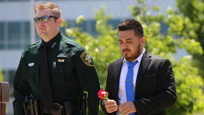 Josh Ramirez is escorted by Madison County Sheriff's Office Deputy Justin Hardin during the National Law Enforcement Day Memorial Service outside of the Carl Perkins Civic Center on Friday, May 13, 2016.