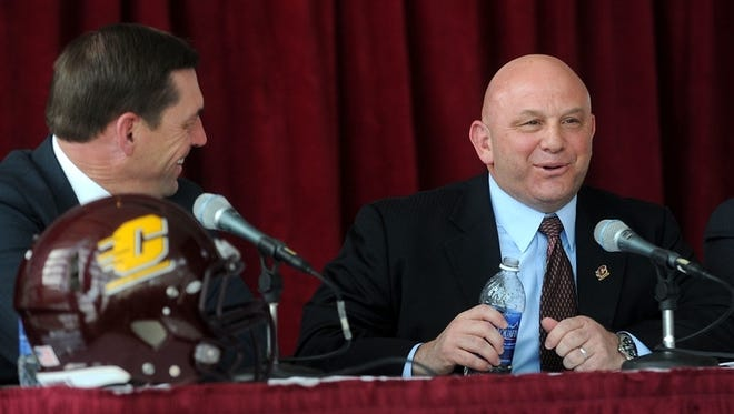 Central Michigan's new head football coach John Bonamego talks with Athletic Director Dave Heeke during a news conference Monday in Mount Pleasant.