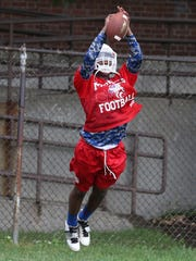 Monroe's Rayshawn Boswell pulls in a pass during coverage