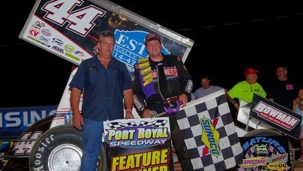 Joey Hershey, right, celebrates in victory lane with his father, Curt, after Joey won his first-ever 410 Sprint race at Port Royal Speedway.