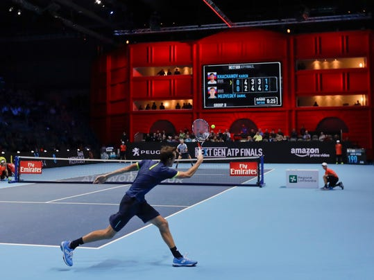 Daniil Medvedev of Russia returns the ball to Karen Khachanov during the ATP Next Gen tennis tournament finals, at the Rho fair, near Milan, Italy, Tuesday, Nov. 7, 2017. (AP Photo/Luca Bruno)