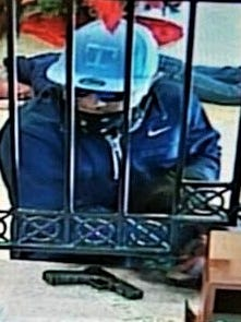 "A man with a ""T"" baseball cap on Dec. 28 robbed the WestStar Bank, 425 E. Redd Road."