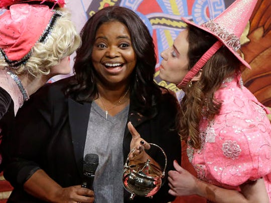 Actress Octavia Spencer is kissed again by members of the Hasty Pudding Theatricals after being presented with the annual Woman of the Year Pudding Pot Award at Farkas Hall Thursday, Jan. 26, 2017, in Cambridge, Mass.