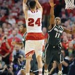 MSU's Tum Tum Nairn can't prevent a 3-point shot by Wisconsin's Bronson Koenig late in regulation during the Badgers' overtime win in last year's Big Ten championship. Nairn is likely to guard Koenig again for at least part of today's game at Wisconsin.
