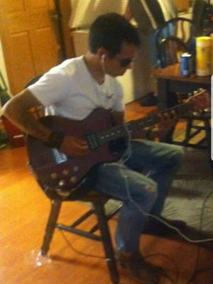 Duane Hostetler Jr., who also used the last name Lopez, plays guitar. Hostetler, 25, was killed early Saturday, Jan. 20, 2018 in a shooting in Abbotsford.