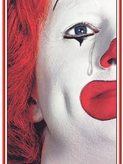 Ronald McDonald sheds a tear in a memorial ad published