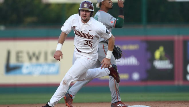 FSU's Cal Raleigh rounds second base on his way to third as the Seminoles defeat Miami 2-0 on Friday at Dick Howser Stadium.