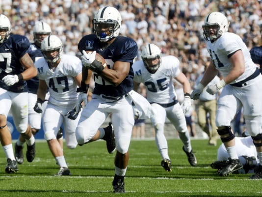 Penn State running back Akeel Lynch rushes the ball for a touchdown in the first half of the Blue-White game on Saturday. The Blue team won the spring scrimmage, 17-7.