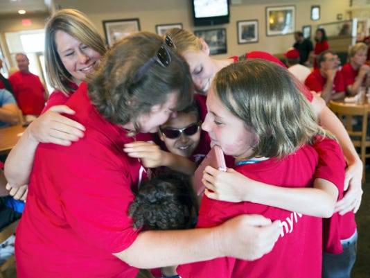 Supporters hold a group hug at Hogan's Bar & Grill in Newberry Township as Japan beat Red Land 18-11 in the Little League World Series championship. Paul Kuehnel - York Daily Record/ Sunday News