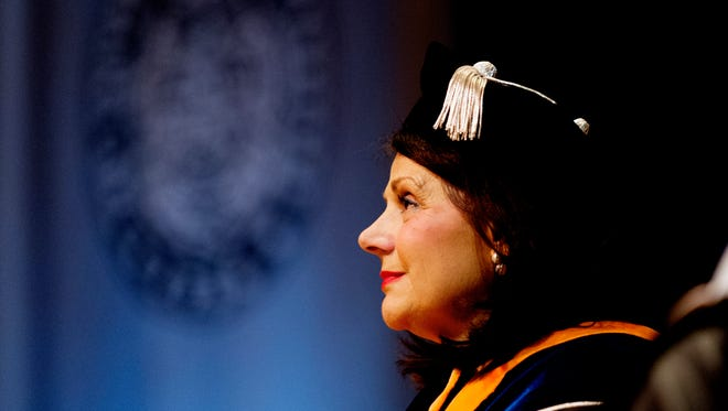 """UT Chancellor Beverly Davenport listens during her """"investiture"""" ceremony at the Alumni Memorial Building in Knoxville, Tennessee on Friday, October 13, 2017."""