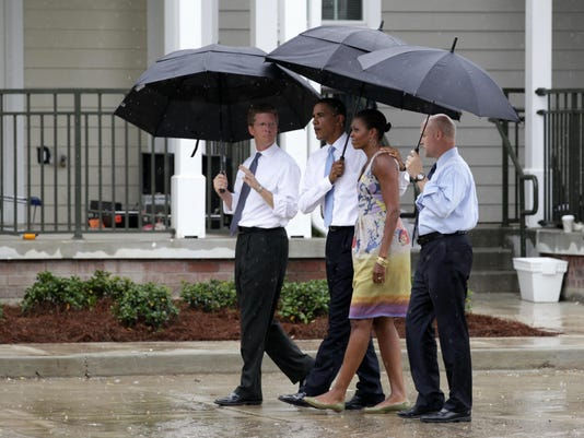 Barack Obama, Michelle Obama, Shaun Donovan, Mitch Landrieu