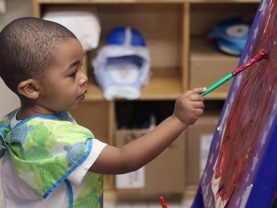 Tamir Turner paints in his birth to three-year-old