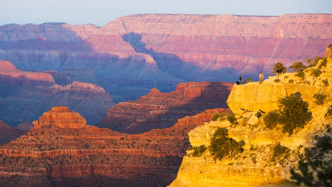 Hikers get a better view of Grand Canyon National Park on April 29, 2015, from Powell Point on the South Rim.
