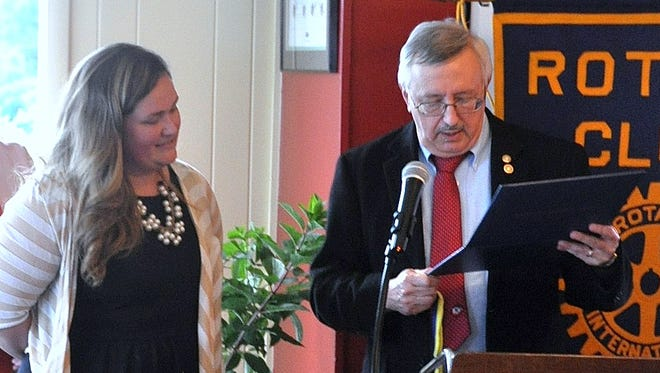Watkins Glen Rotarian Chris Burns presents Meredith Williams with a Paul Harris Fellow award.