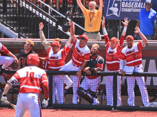 Louisville's Drew Ellis, left, turns to his cheering teammates in the dugout after his three-run homer sails over left field fence in the bottom of the fifth inning to put the Cards up 5-2 over Kentucky in the first game of the Super Regional Friday.