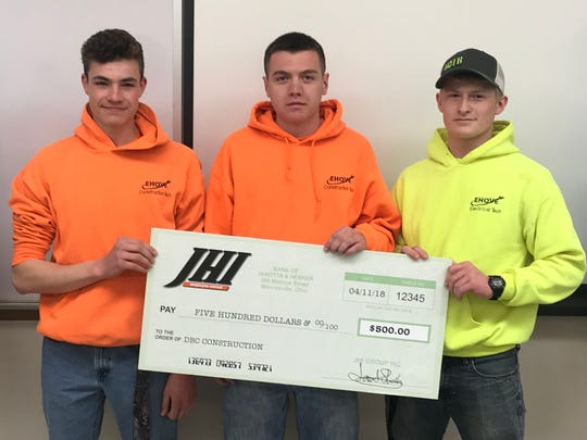 EHOVE Construction Tech students Caden Cooper and Jared Battle, both of Edison High School, and EHOVE Electrical Tech student Dakota Doyon of New London High School, were awarded $500 from Janotta & Herner.