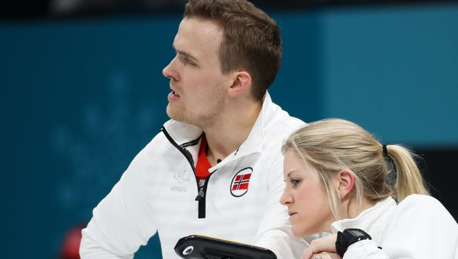 Magnus Nedregotten (L) of Norway and teammate Kristin Skaslien in the Mixed Doubles Bronze Medal match between Norway and Olympic Athletes of Russia at the Gangneung Curling Centre in Gangneung during the PyeongChang Winter Olympic Games.