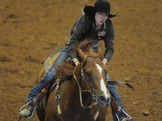 Abilene's Danielle Harmon and her horse, Cajun, compete in the final go-round at the Texas High School Rodeo Association State Finals on Saturday, June 10, 2017 at the Taylor County Coliseum.