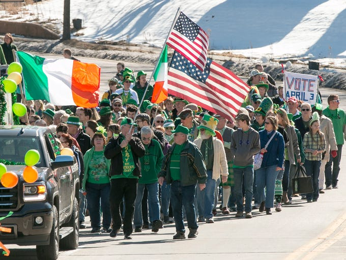 People celebrate St. Patrick's Day during the Irishman's
