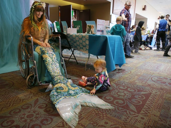 Millie Schlia, 1, of Rochester is captivated by the