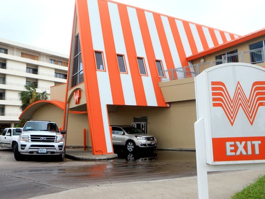 Customers wait for their meals as Whataburger by the