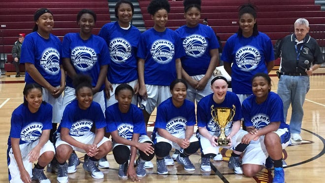 The Howard Wildcats are all smiles after winning the Delaware Cup at the Diamond State Classic girls basketball tournament on Friday at the St. E Center.