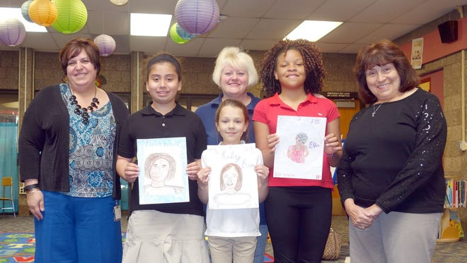 The Woman's Club of Vineland recently announced the winners of its Design a Stamp Contest at Mennies Elementary School. (From left) Kristen Speakman, assistant principal, Mennies Elementary School, Denise Gonzalez, third place, Skylar Viruet, second place, Lisa Arena, principal, Mennies Elementary School, Inesha Rivera, first place, and Linda Gallina, educational chairperson, Woman's Club of Vineland, are pictured.