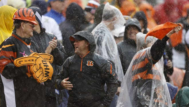 Bengals fans get rained on during a 2013 game against the Cleveland Browns at Paul Brown Stadium.