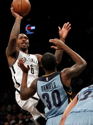 Brooklyn Nets guard Sean Kilpatrick (6) puts up a shot against Memphis Grizzlies guard Troy Daniels (30) in the fourth quarter at Barclays Center on Feb. 13.