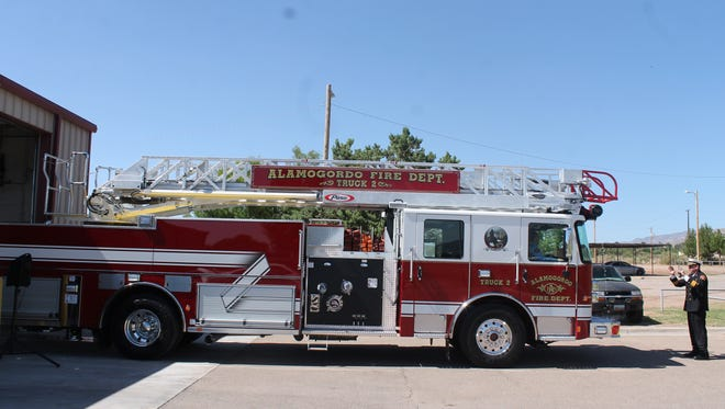 Deputy Chief Jim LeClair guiding Fire Truck #2 pulling out for firefighting ritual Wetdown