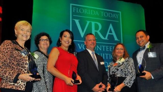 VRA Award winners (left to right) Mary Allen,  Kristen Snyder,  Susan Hammerling, Jeff Kiel, president and publisher of FLORIDA TODAY; Angela Brock for her husband David Brock; and Mark Malek at the 23rd FLORIDA TODAY Volunteer Recognition Awards last year.
