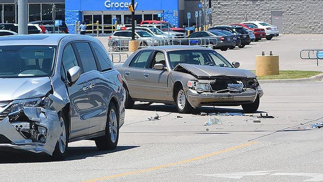 Newton Police Department officers attend to an accident Monday afternoon at the intersection of South Kansas Avenue and Medical Center Drive.
