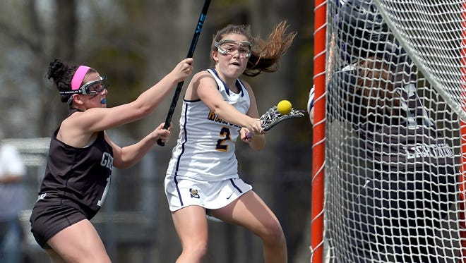 Spencerport junior Erin Coykendall, right, is a two-time All-Greater Rochester pick in lacrosse and soccer.