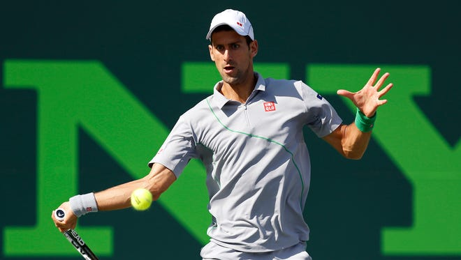 Novak Djokovic hits a forehand against Andy Murray (not pictured) on day ten of the Sony Open at Crandon Tennis Center on Wednesday.
