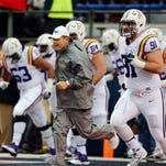 LSU head coach Les Miles leads his team out on the field for the second half of an NCAA college football game against Mississippi in Oxford, Miss., Saturday, Nov. 21, 2015. No. 25 Mississippi won, 38-17. (AP Photo/Rogelio V. Solis)