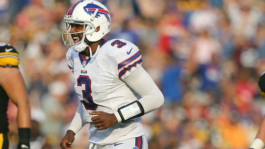 Bills QB EJ Manuel is all smiles as he runs to congratulate