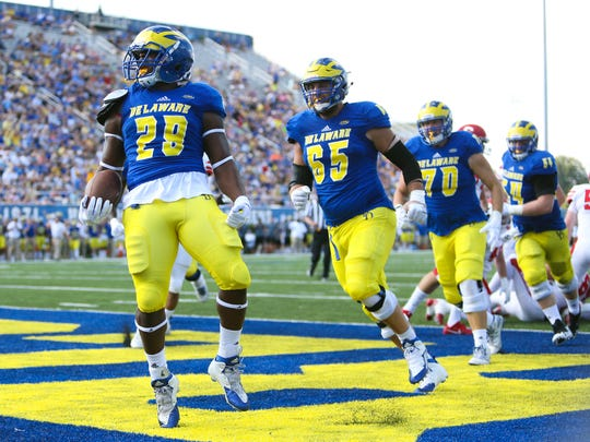 Delaware running back Kani Kane celebrates his first-quarter score against Cornell.