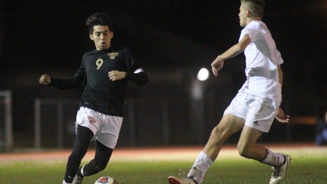 Florida High's Ricky Serrano makes a move against a Maclay defender.